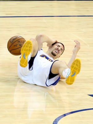 Golden State Warriors guard Klay Thompson (11) lays injured during the fourth quarter against the Houston Rockets in game five of the Western Conference Finals of the NBA Playoffs at Oracle Arena.