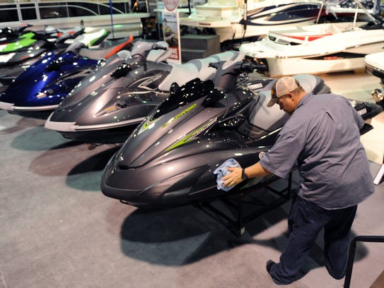 Wesley Allen of Tims Ford Power Sports polishes Yamaha