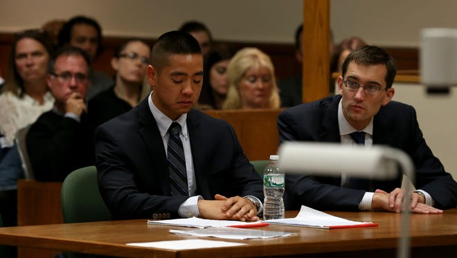 Charles Tan becomes emotional after his defense attorney James Nobles describes the abusive nature of Tan's father toward his mother.