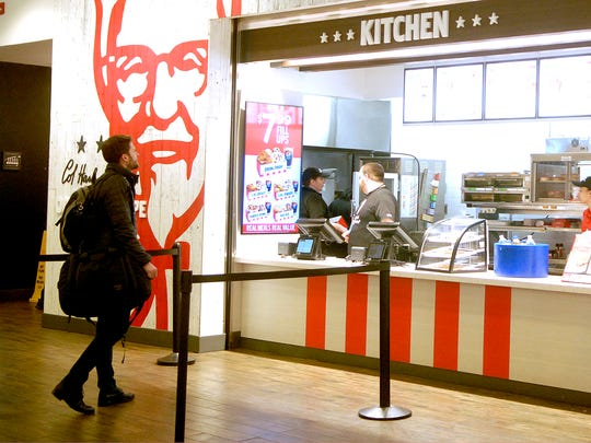 A man decides what to eat at the Kentucky Fried Chicken in the Louisville International Airport.  Dec. 15, 2017
