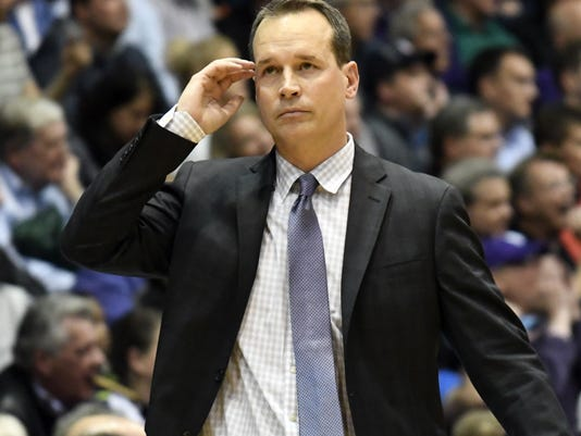 Northwestern coach Chris Collins reacts to a play against Illinois during the second half of an NCAA college basketball game Tuesday, Feb. 7, 2017, in Evanston, Ill. Illinois won 68-61. (AP Photo/David Banks)