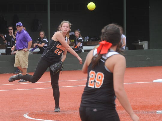 Viola pitcher Destiny Crawford throws to Haylee Connors at first base for an out during the Lady Longhorns' 5-1 loss to the Concord Lady Pirates on Tuesday in the semifinals of the Class 1A State Tournament at Conway.