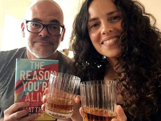 Matthew Quick and wife Alicia Bessette toast publication