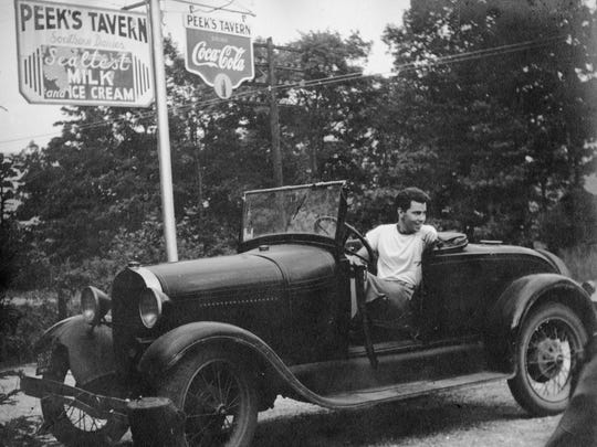 Ray Spillenger pulls away from Peek's Tavern in Black Mountain in Roger Hewitt's car during his time at Black Mountain College during the summer of 1948.