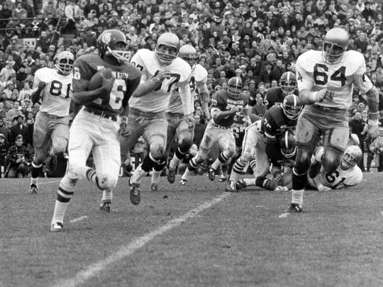 Michigan State's Jimmy Raye carries the ball against