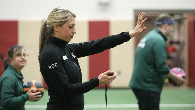 """Janna Luksha, who is deaf, is a certified personal trainer for a small group of deaf, hard of hearing and hearing people who want to learn sign language at the Penfield YMCA. """"I started the class where people could come together and work out together and share in the language and the culture,"""" said Luksha."""