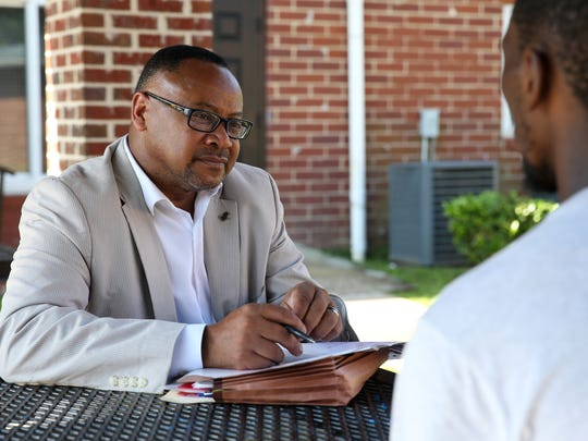 Kimball Thomas talks to Brian King about COT's new TEMPO program at Sunrise Place Apartments Oct 12. King, a father of two, wants to get his GED so that he can apply for college.