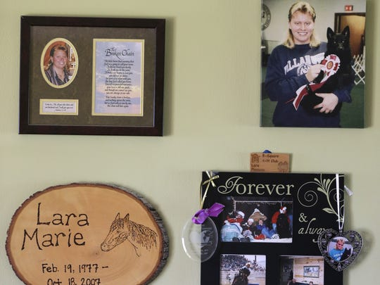 Photos of Lara Plamann hang on the wall of her parent's