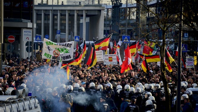 Protesters demonstrate on Jan. 9, 2016, against New Year's Eve attacks in Cologne, Germany.
