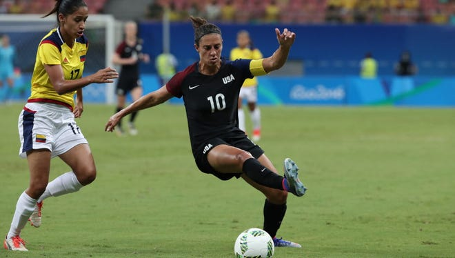 American Carli Lloyd, right, works to control the ball ahead of Colombia defender Carolina Arias, left, during their first-round match in the Rio 2016 Summer Olympic Games.