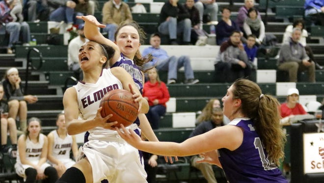 Kiara Fisher of Elmira tries for a layup as Taylor Hansen, center, and Halea Eaton of Norwich defend Jan. 27 at Elmira High School.
