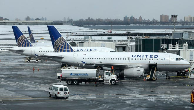 United Airlines jets sit on the tarmac at LaGuardia Airport in New York on March 15, 2017.