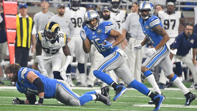 Lions wide receiver Golden Tate scrambles up field after a reception in the first quarter.