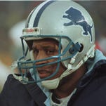 Detroit Lions running back Barry Sanders  stands on the sideline during a loss  at Chicago in 1996.
