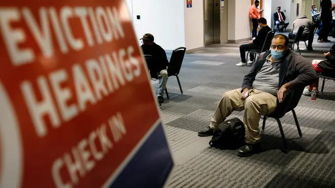 Columbus resident Julian Hoe, 38, was among dozens of renters waiting for hearings on their eviction cases Thursday at the Greater Columbus Convention Center, where Franklin County Municipal Court moveds its traffic and eviction dockets. He lost his previous job and hopes to be able to catch up in a new position as a security guard.