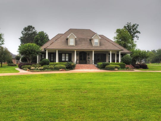 Massive and sprawling, this Haughton property was custom