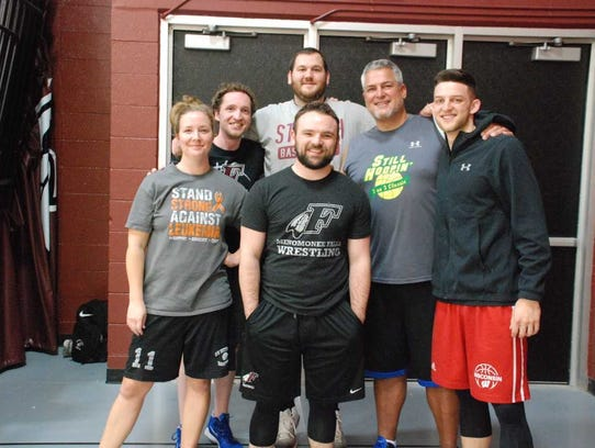 Zak Showalter (right) poses with members of the faculty team he played with during a basketball fundraiser that benefited Austin Trzebiatowski, a Menomonee Falls High School freshman battling leukemia.