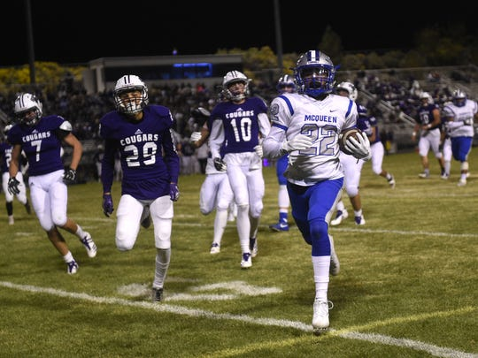 McQueen's Kenyon Perez runs for a score against Spanish Springs during their football game at Spanish Springs on Sept. 29.