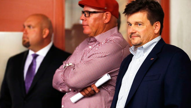 Arizona Cardinals President Michael Bidwill (right),coach Bruce Arians and General Manager Steve Keims (back) listen to first-round draft pick Deone Bucannon at a press conference on Friday, May 9, 2014 at the Cardinals' training facility in Tempe.