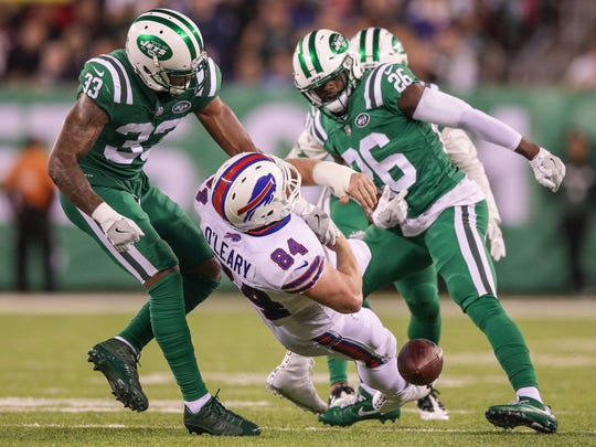 Nov 2, 2017; East Rutherford, NJ, USA; Buffalo Bills tight end Logan Thomas (82) fumbles as New York Jets strong safety Jamal Adams (33) and free safety Marcus Maye (26) defend during the second half at MetLife Stadium. Mandatory Credit: Vincent Carchietta-USA TODAY Sports