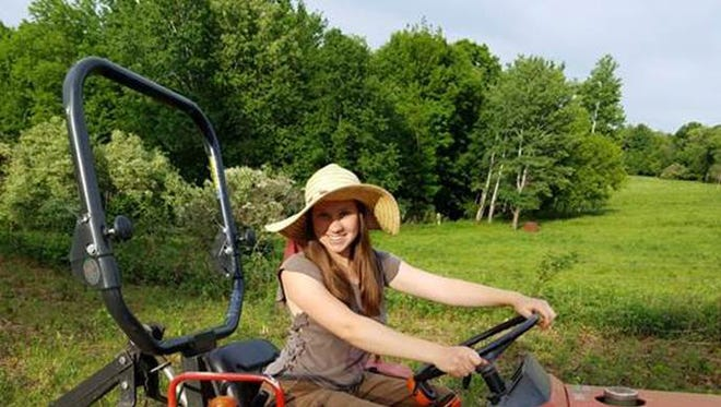 Marie Kilde on her father's Yanmar 1700 BD, newly retrofitted with a rollbar through the National Farm Medicine Center's Wisconsin Rollover Protective Structure (ROPS) Rebate Program, open to all Wisconsin farmers.