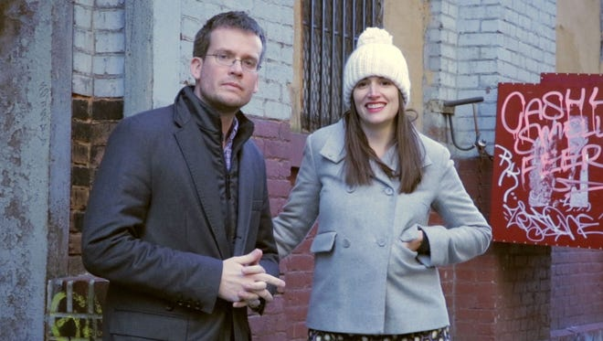 "John Green and Sarah Urist Green pose outside the New York City studio of artist David Brooks during an episode of ""The Art Assignment"" online video series."