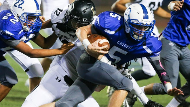 Lake View's Elliott Peterson runs the ball as Lubbock defender tackles Friday, Oct. 20, 2017, at San Angelo Stadium.