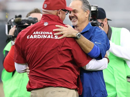 Indianapolis Colts head coach Chuck Pagano,right, is greeted by Arizona Cardinals head coach Bruce Arians,left, prior to their game. Indianapolis Colts play the Arizona Cardinals Sunday, November 24, 2013, afternoon at the University of Phoenix Stadium in Glendale AZ.  Matt Kryger / The Star