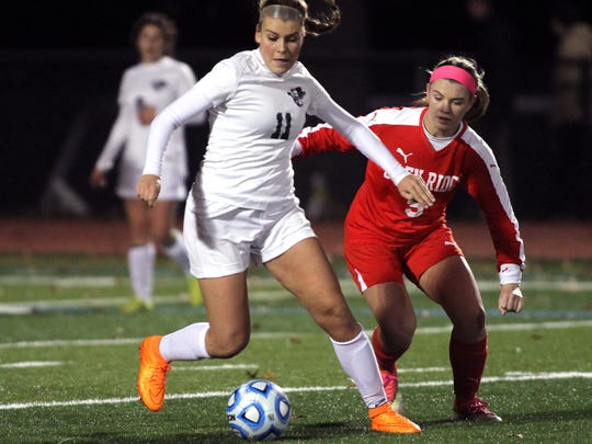 Kinnelon's Ida DiClemente controls the ball in front