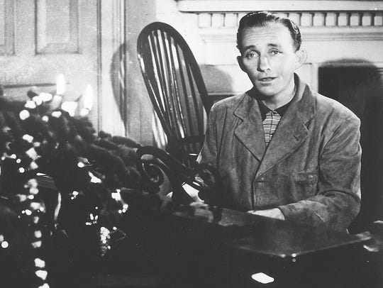 "Bing Crosby sings ""White Christmas"" in a scene from"