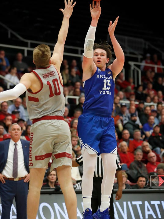 BYU forward Payton Dastrup (15) shoots over Stanford forward Michael Humphrey (10) during the second half of an NCAA college basketball game in the first round of the NIT, Wednesday, March 14, 2018, in Stanford, Calif. (AP Photo/Tony Avelar)