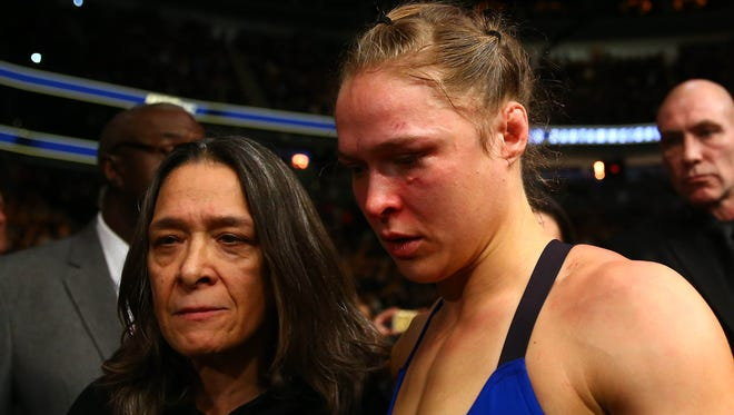 Rousey leaves with her mother AnnMaria De Mars follwing her loss.