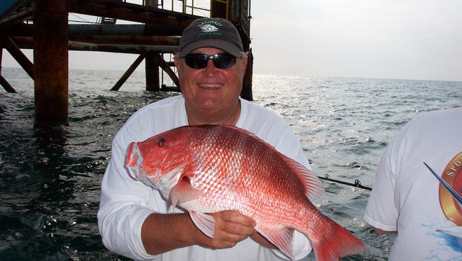 Outdoors Editor Bobby Cleveland with a red snapper in the Gulf of Mexico.