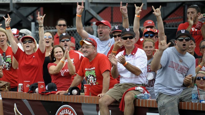 "UL baseball fans react to the team receiving a sixth overall seed in the NCAA baseball tournament while watching the selection show at M.L. ""Tigue"" Moore Field in Lafayette on Monday."