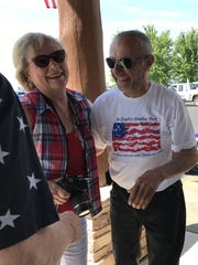 Mike Spaude, right, and his cousin Lois Gard talk Friday, July 28, at Viking Land Harley-Davidson near Sauk Rapids after Spaude's return from a cross-country motorcycle ride and fundraiser.