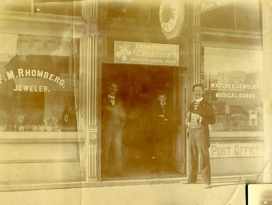 Frank Rhomberg in front of his jewelry store and post