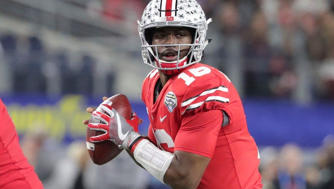 Ohio State quarterback J.T. Barrett (16) looks to pass as offensive lineman Billy Price (54) blocks Southern California defensive tackle Josh Fatu (98) during the first half of the Cotton Bowl NCAA college football game in Arlington, Texas, Friday, Dec. 29, 2017. (AP Photo/LM Otero)