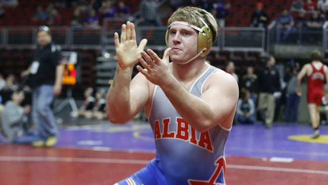 Albia's Carter Isley celebrates his win Friday during the Class 2A semifinals.