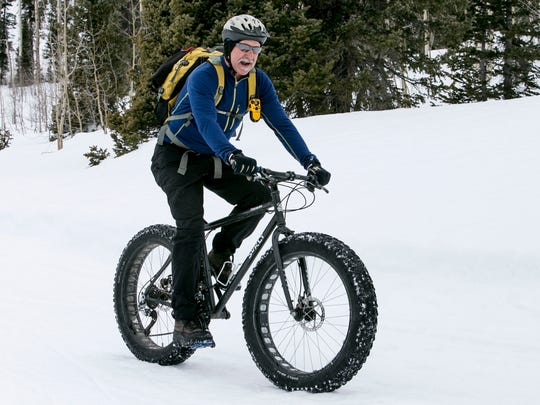 Topher Mason loves riding his Surly snow bike around Deer Valley in Cedar Canyon. Wider tires allow for better grip, giving bike enthusiasts another option for winter recreation.