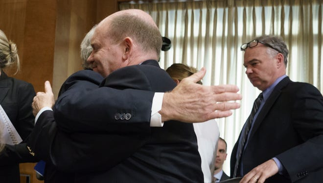 Sen. Chris Coons, D-Del., is embraced by Senate Foreign Relations Committee Chairman Bob Corker, R-Tenn., left, after Coons helped to end a dramatic vote for President Donald Trump's nominee for secretary of state, Mike Pompeo, who has faced considerable opposition before the panel, on Capitol Hill in Washington, Monday, April 23, 2018.