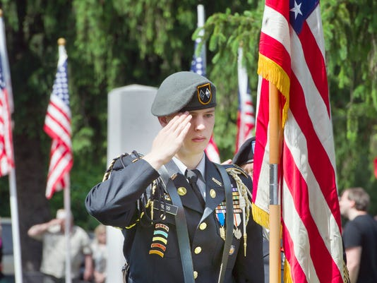 Nicholas Ross, with the William Penn Army JROTC, salutes while the group brings in the flags for the annual Memorial Day Service at Veterans Memorial Park in York Monday. YORK DAILY RECORD/SUNDAY NEWS - PAUL KUEHNEL