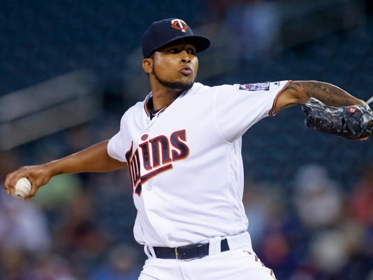 Minnesota Twins pitcher Ervin Santana throws against the Kansas City Royals during the first inning of a baseball game Tuesday, Sept. 6, 2016, in Minneapolis. (AP Photo/Jim Mone)