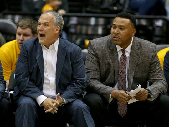 Southern Miss assistant coach Clarence Weatherspoon, right, watches alongside head coach Doc Sadler during a recent game at Reed Green Coliseum.