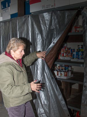 Dena Holloway shows off  storage space used for canned goods in 2013. Her charity, Santa House, has lost the facility they've used since 2014. This will affect hundreds of needy families this winter.