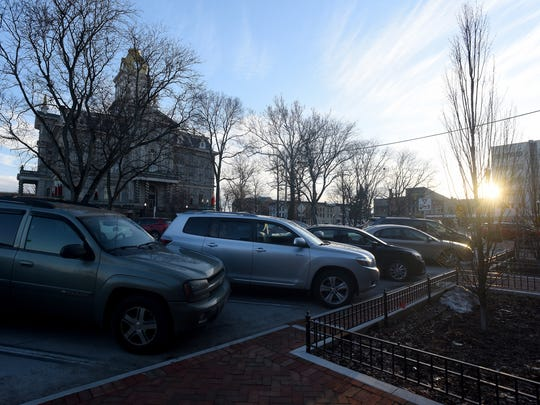 Parking along the North side of the square in downtown Newark. A parking enforcement plan will be considered Monday night by council's Safety Committee.