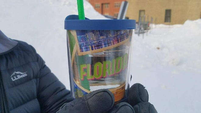 Detective Steve Pelletier of the Bangor Maine Police Department poses with a Florida insulated tumbler cup.