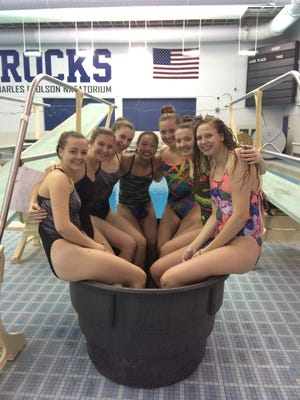 These Plymouth High School swimmers will compete at the Division 1 state finals. From left are Alyssa Crisp, Ellie Kendall, Grace MacLellan, Vy Nguyen, Kelsey Peregord, Regan Peregord and Liz Breda.