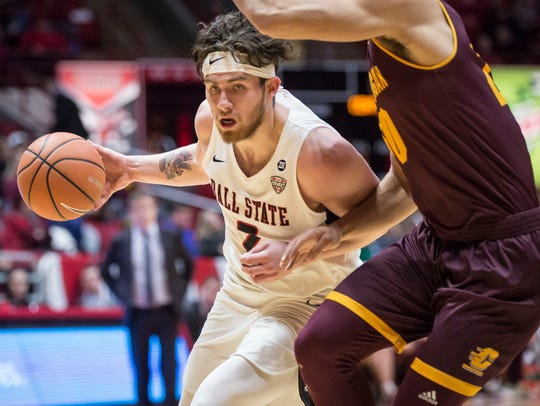 Ball State's Tayler Persons drives into Central Michigan's