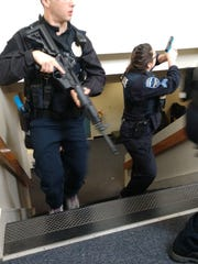 Burlington police officers trained in Colchester to respond in teams and as individuals to school shooting scenarios in April, 2018.