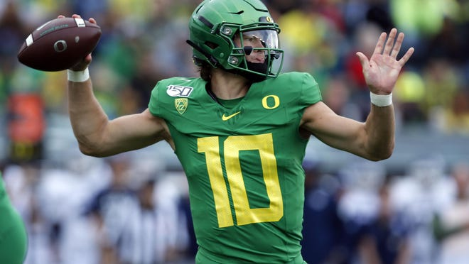 Former Oregon quarterback Justin Herbert was the sixth overall pick of April's NFL draft by the Los Angeles Chargers. [Andy Nelson/The Register-Guard] - registerguard.com